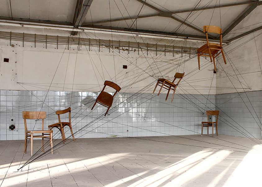 Sculpture of flying chairs